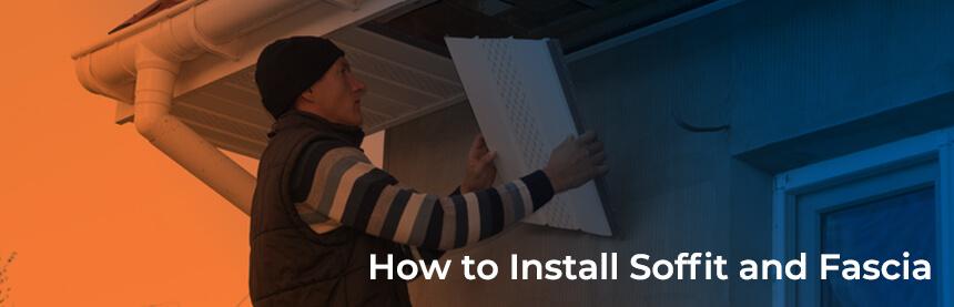 A man installing soffit